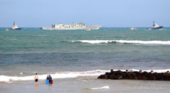 ex HMAS Canberra passing by Point Lonsdale on tow to the scuttling site