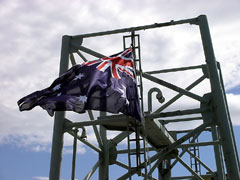 Australian flag flying on the ex HMAS Canberra on tow to the scuttling site