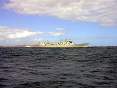ex HMAS Canberra leaving Port Phillip Bay on tow to the scuttling site